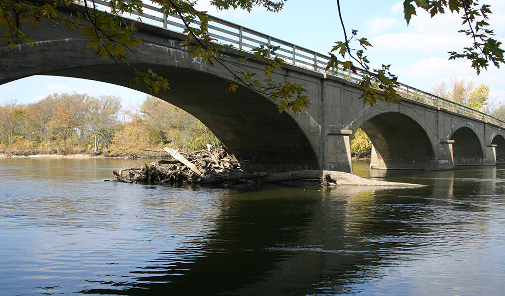 bridge over water with large archways