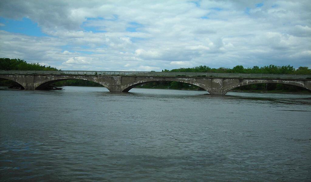 long arched bridge over river