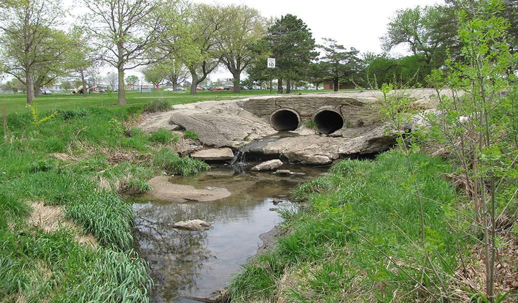 broken down double culvert on narrow stream