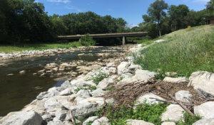 restored streambank with rip rap rock