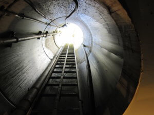 tunnel view from bottom of sac city pump looking up ladder